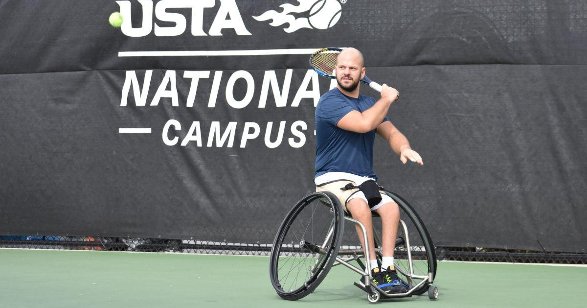 male wheelchair tennis player Stefan Olsson plays a forehand on a hard court