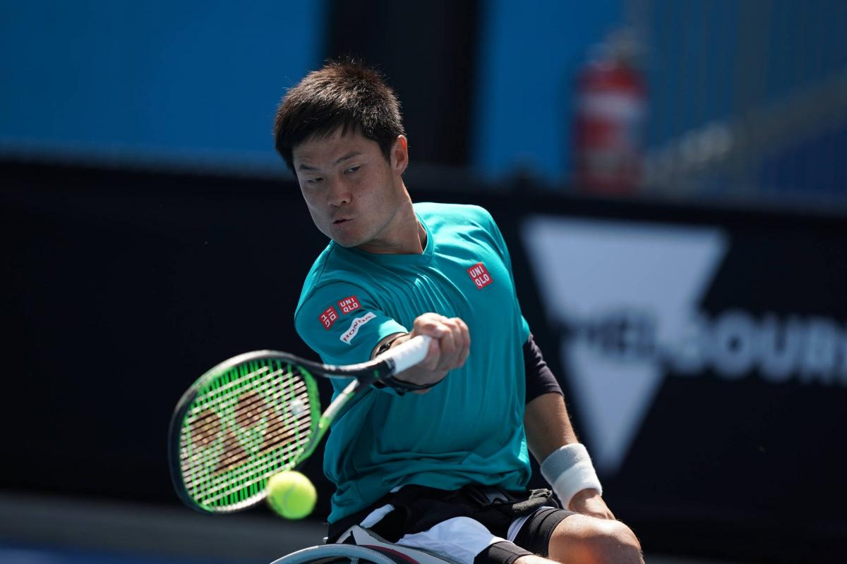 male wheelchair tennis player Shingo Kunieda plays a forehand on a hard court