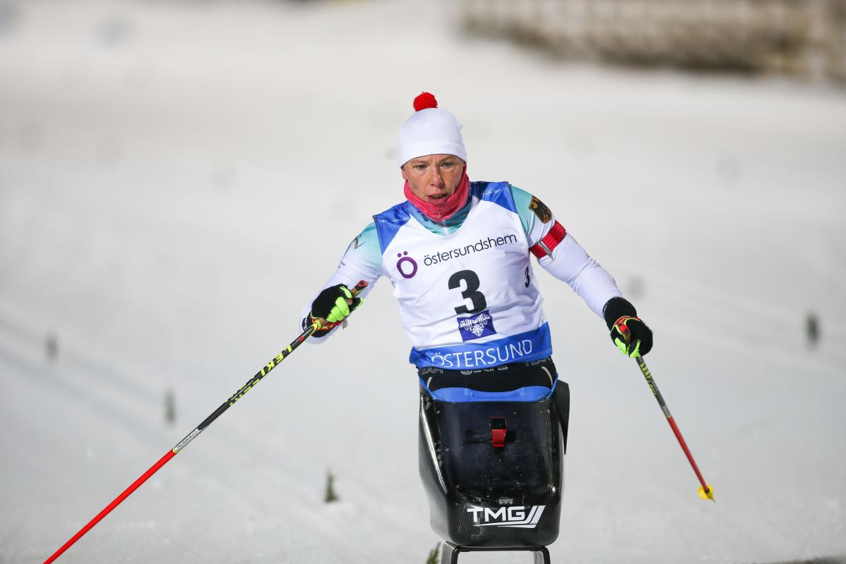 female Para Nordic skier Andrea Eskau steers on the ski course