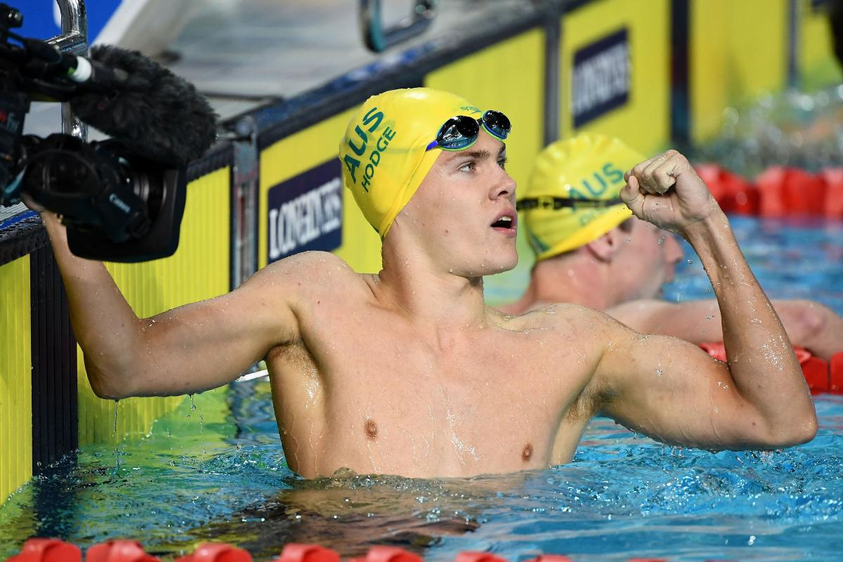 male Para swimmer Timothy Hodge fistpumps after winning a race