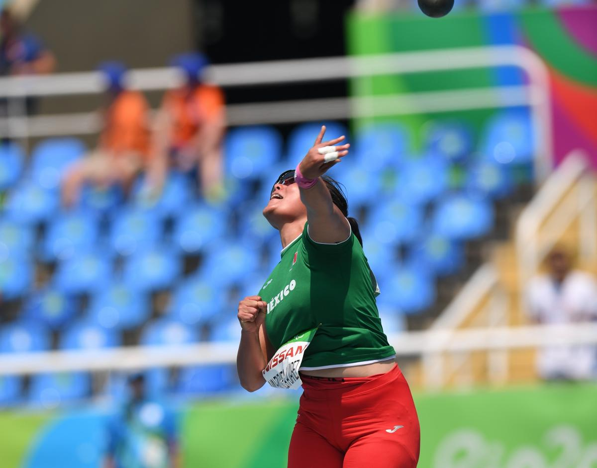 female Para athlete Rebeca Valenzuela Alvarez throws the shot put