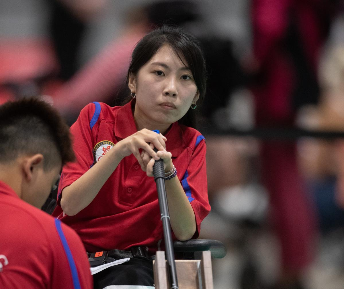 female boccia player Yuen Kei Ho watches a ball being played