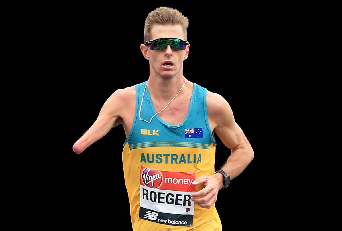 male Para athlete Michael Roeger running on the streets of London