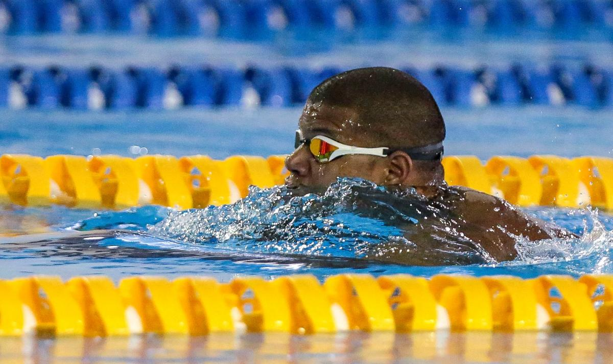 Lorenzo Perez Escalona swimming breaststroke in a pool