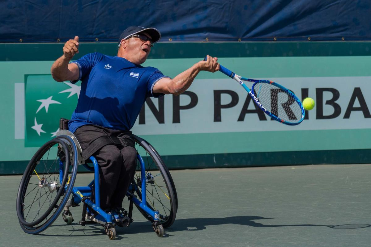 Israeli left-handed wheelchair tennis player Shraga Weinberg hits the ball during a game contested on a hard court