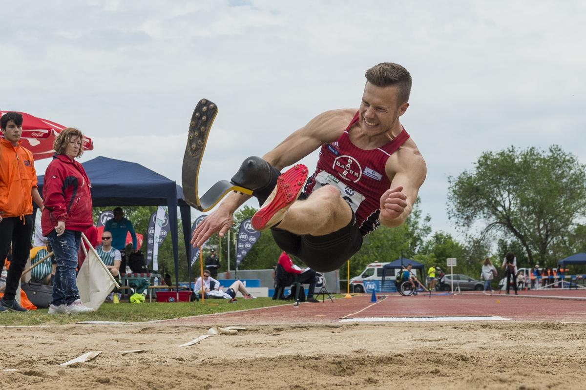 A man with a prosthetic leg competing in long jump