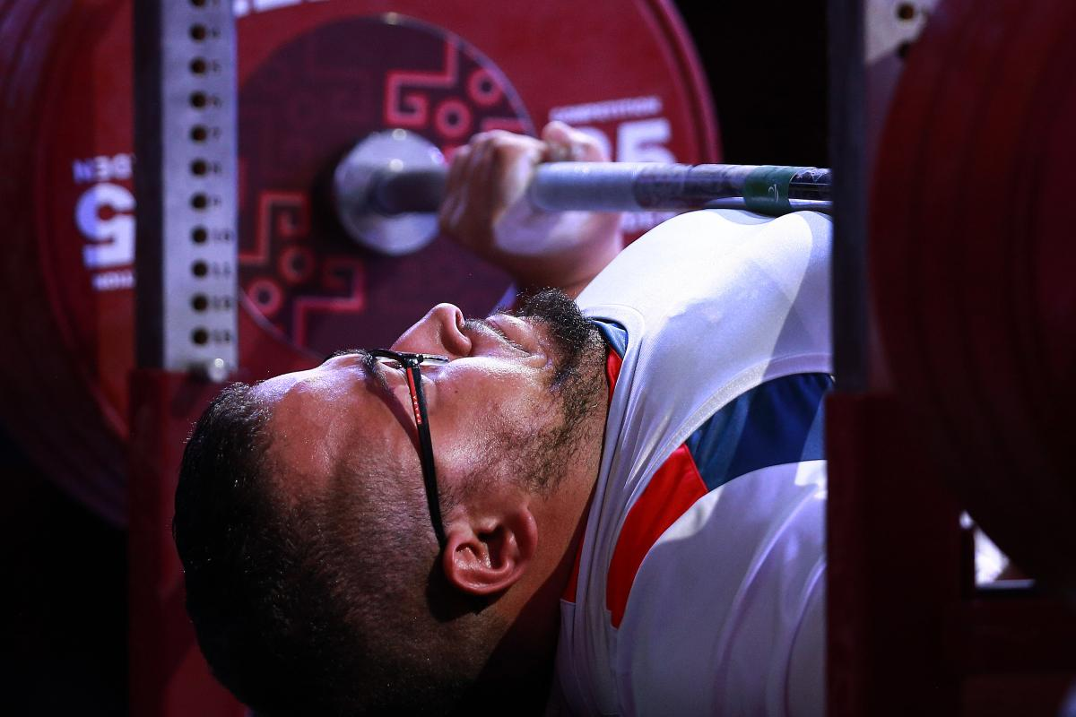 French powerlifter Rafik Arabat lifts the bar