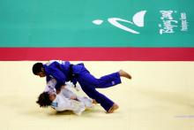 Athletes practicing judo.
