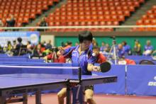 A chinese person playing Table Tennis