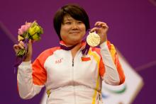 Zhang Cuiping celebrates with her gold medal