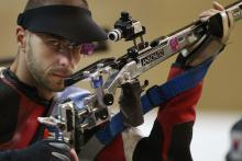 Matthew Skelhon of Great Britain catches a glimpse of the camera while competing in the mixed R6-50m Rifle Prone- SH1 final