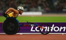 A picture of a man in a wheelchair racing during an athletics event