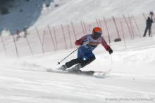 A picture of a man skiing on the slopes