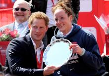 Prince Harry presents Tatyana McFadden with her 2013 London Marathon trophy