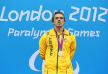 A picture of a man standing with a gold medal around his neck