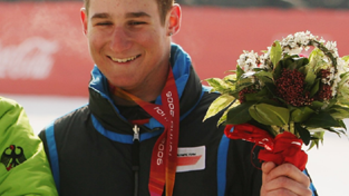 A picture of a man showing his bronze medal