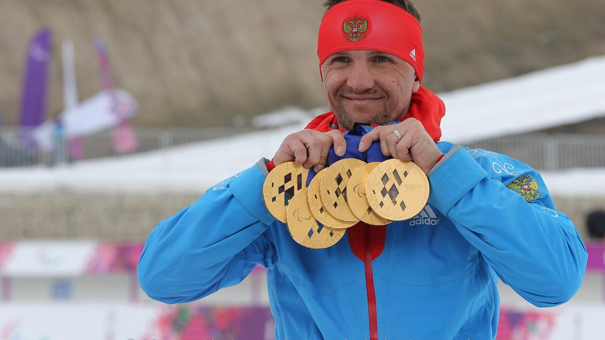 Roman Petushkov, Russia showing off his six gold medals